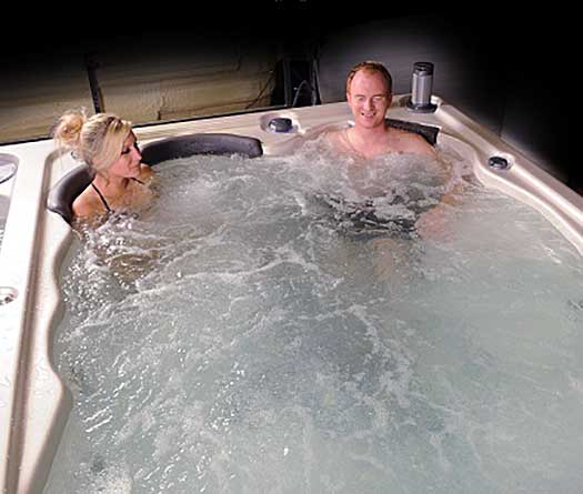 Couple relaxing in the hot tub end