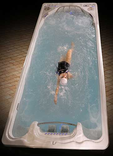 Woman Exercising in Executive Swim Spa Series